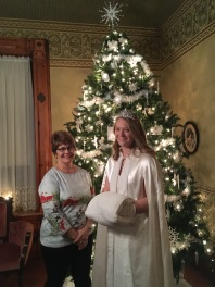 Sue Hurd VanAmburg poses with Snow Princess in front of Parlor's tree